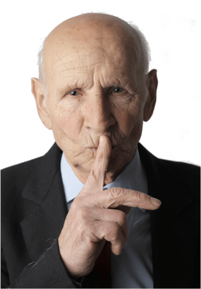 Elderly gentleman with his finger to his lips - Shhh - Be Silent
